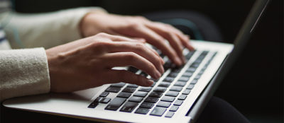 person typing on laptop featured image
